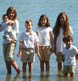 A group of cousins in the water at the end of an extended family sitting in Harpswell!