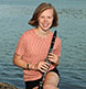 A high school senior at our Harpswell studio with her clarinet.